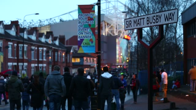 Supporters arrive at Manchester United's Old Trafford Stadium in Salford north west England on January 26 Ext Old Trafford Stadium at Old Trafford on...