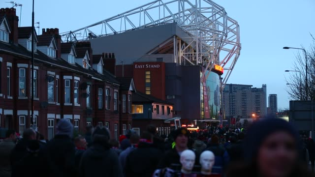 Supporters arrive at Manchester United's Old Trafford Stadium in Salford north west England on January 26 Supporters outside Old Trafford Stadium at...