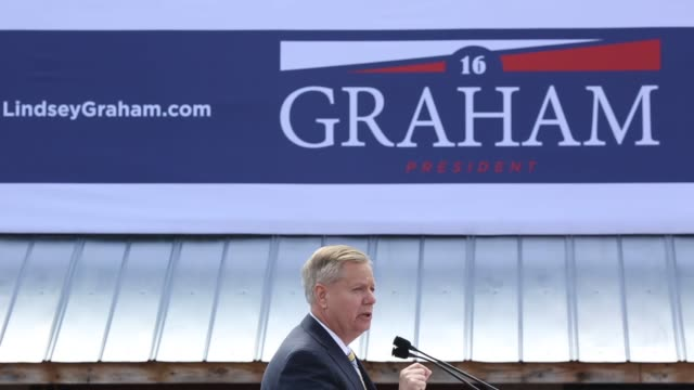 supporters assemble and campaign staff prepare for republican senator lindsey graham to announce the launch of his campaign to seek the 2016... - us republican party 2016 presidential candidate stock videos & royalty-free footage
