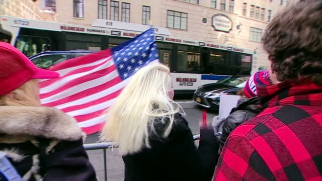 supporters at a protrump rally outside trump tower in new york city - unterstützer stock-videos und b-roll-filmmaterial