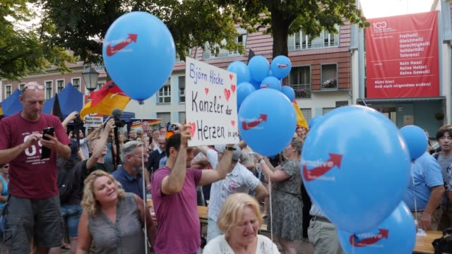supporters attend the final afd campaign trail stop before the elections and listen to the speech of björn höcke head of the alternative fuer... - deutschland stock videos & royalty-free footage