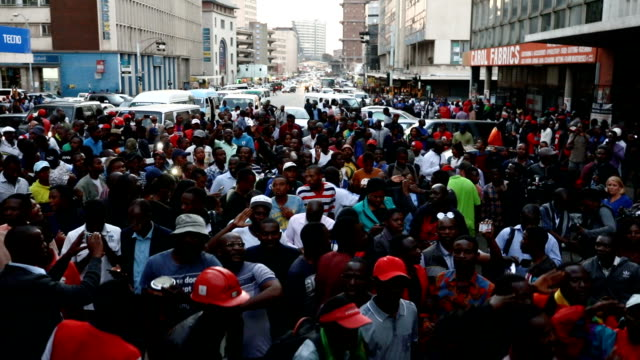 mdc supporters celebrate in the street outside the mdc headquarters despite the election result as yet not been announced on july 31 2018 in harare... - zimbabwe stock videos & royalty-free footage
