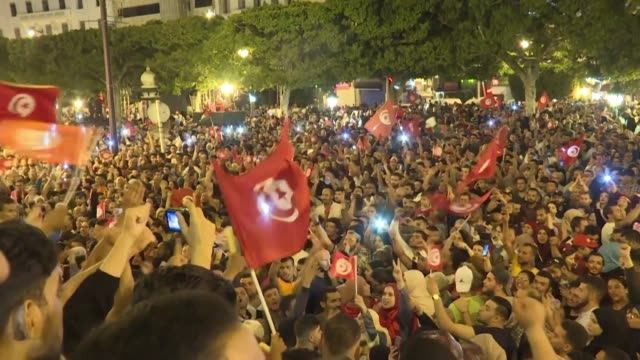 supporters celebrate on the capital's streets as conservative academic kais saied a political outsider was headed for a landslide victory in... - tunisia stock videos & royalty-free footage