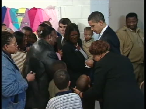 """supporters chant the """"fired up! ready to go!"""" slogan to barack obama at a darlington, south carolina church during his 2008 campaign for president.... - nomination stock videos & royalty-free footage"""