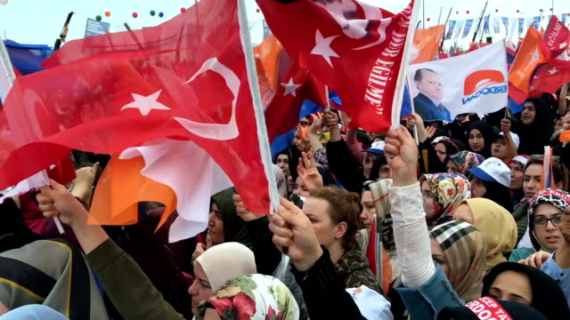 Supporters cheer and salute as they listen to Turkey's President Recep Tayyip Erdogan speak during a AK Parti election rally on June 17 2018 in...