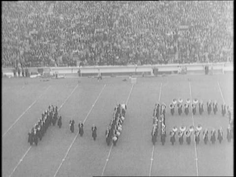supporters form nd on the field / usc' s bob robertson throws football to ralph heywood scores a touchdown / notre dame blocks southern california... - anno 1941 video stock e b–roll