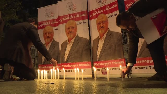 supporters friends and relatives of the journalist jamal khashoggi hold a candlelight vigil outside the saudi consulate in istanbul to demand justice... - memorial vigil stock videos & royalty-free footage