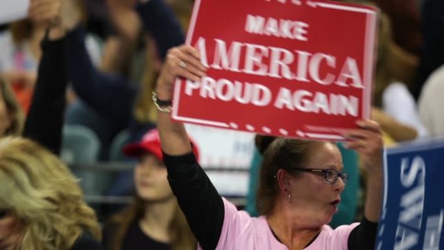 Supporters get pumped up as they wait to hear from President Donald Trump during a campaign rally at the MidAmerica Center on October 9 2018 in...
