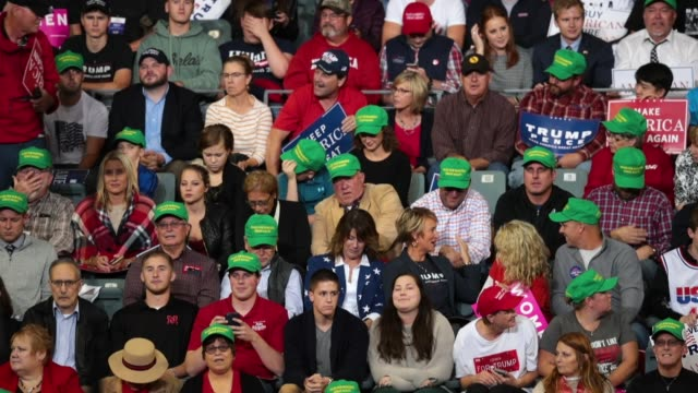 supporters get pumped up as they wait to hear from president donald trump during a campaign rally at the midamerica center on october 9 2018 in... - iowa stock videos & royalty-free footage