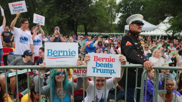 supporters hold signs as bernie sanders speaks during the polk county steak fry in des moines iowa the event political event was attended by all 17... - election stock videos & royalty-free footage