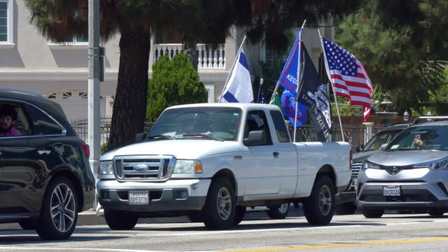 supporters in cars with american and israel flag driving in los angeles, california, 4k - political rally stock videos & royalty-free footage