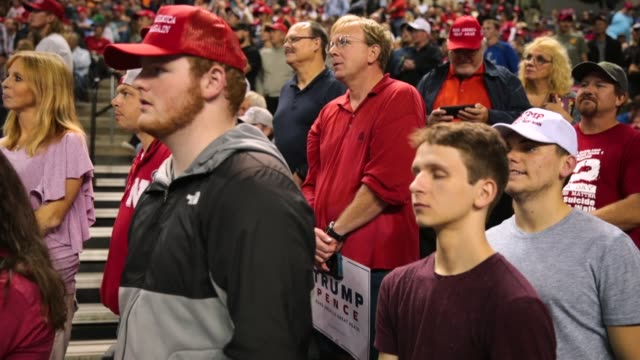 supporters listen as president donald trump speaks at a campaign rally at the midamerica center on october 9 2018 in council bluffs iowa - iowa stock videos & royalty-free footage