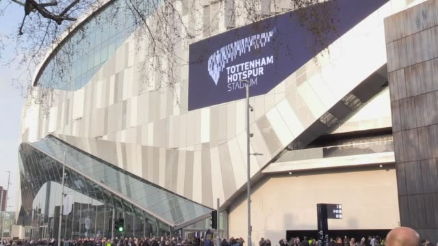 supporters make their way to the new tottenham hotspur stadium ahead of spurs' champions league quarter-final first leg clash with manchester city. - leg press stock videos & royalty-free footage