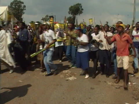 anc supporters march through the streets of soweto - soweto stock videos and b-roll footage