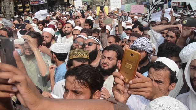 supporters of a religious group chant slogan during a rally favoring the khalid khan, who gunned down tahir naseem in courtroom, in peshawar,... - peshawar stock videos & royalty-free footage