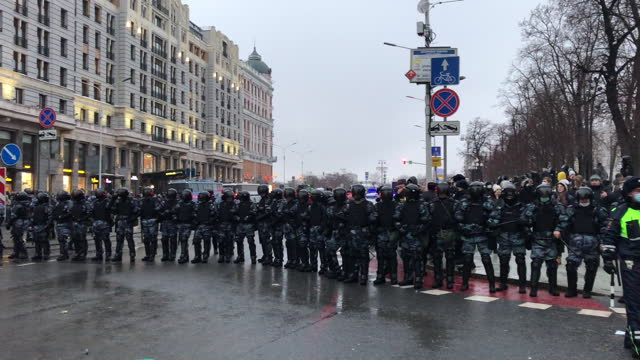 supporters of alexey navalny, opposition leader, being pacified by police on pushkinskaya square in moscow, russia, on saturday, january 23, 2021. - protestor stock videos & royalty-free footage