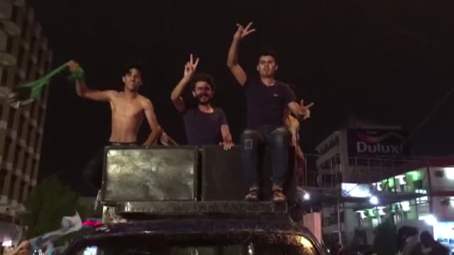 supporters of an alliance between shiite cleric moqtada sadr and communists celebrate in downtown baghdad - muqtada al sadr stock videos & royalty-free footage