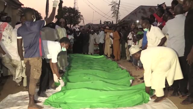 supporters of an imprisoned shiite cleric attend a funeral for dozens of people they say were killed in clashes with the nigerian security forces - shi'ite islam stock videos & royalty-free footage