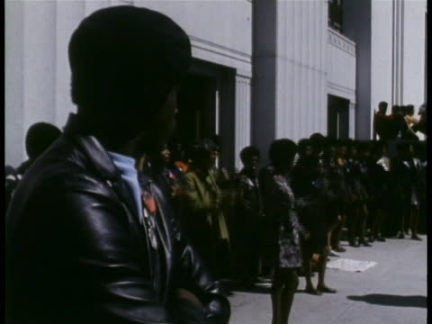 supporters of black panther huey newton and other black panther members gather and demonstrate outside of the alameda courthouse. - social movement stock videos & royalty-free footage