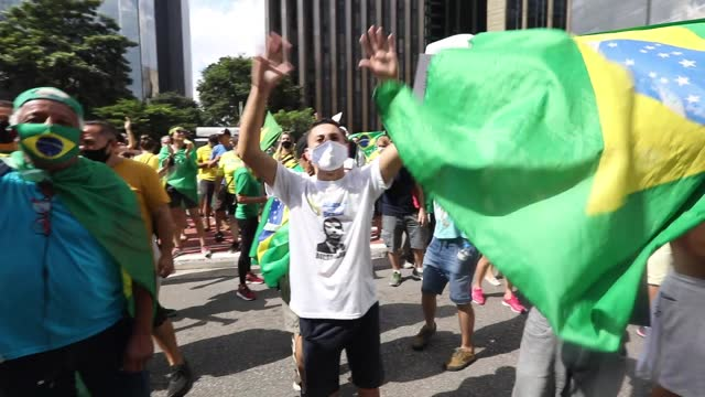 supporters of brazilian president jair bolsonaro protest and hold banners during a motorcade and demonstration in favor of the government amidst the... - avenida paulista stock videos & royalty-free footage