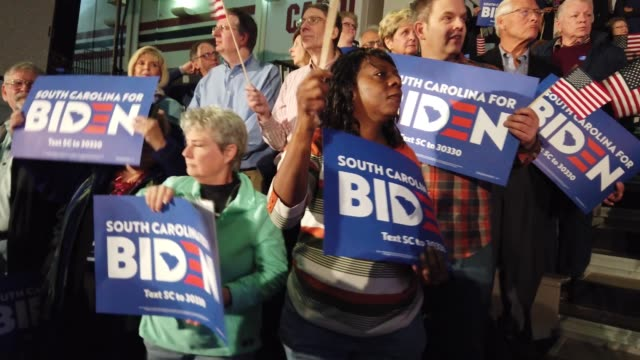 supporters of democratic presidential candidate former vice president joe biden wait for him to speak at an electionnight rally at the university of... - columbia center stock videos & royalty-free footage