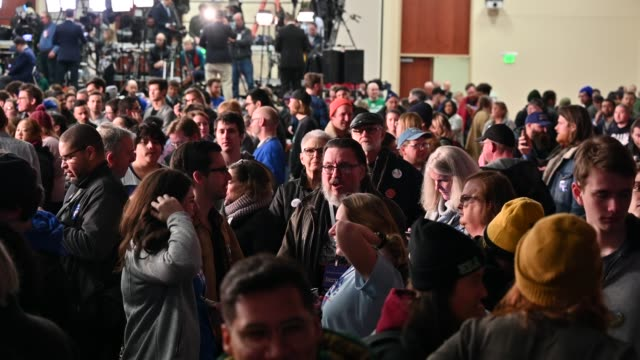 supporters of democratic presidential candidate sen bernie sanders wait for election results at a caucus night party on february 3 2020 in des moines... - iowa stock videos & royalty-free footage