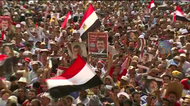 supporters of deposed president mohamed morsi gather in opposition to the 2013 egyptian military coup - (war or terrorism or election or government or illness or news event or speech or politics or politician or conflict or military or extreme weather or business or economy) and not usa stock videos & royalty-free footage