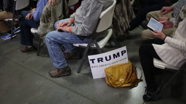 Supporters of Donald Trump president and chief executive of Trump Organization Inc and 2016 Republican Presidential candidate listen to him deliver a...
