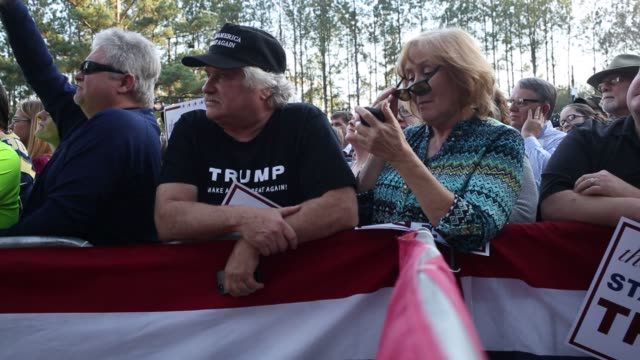 supporters of donald trump, president and chief executive of trump organization inc and 2016 republican presidential candidate, stand and listen to... - zweiter platz stock-videos und b-roll-filmmaterial