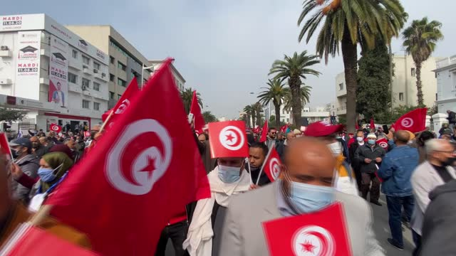supporters of ennahda movement in tunisia stages a demonstration on february 27, 2021 in tunis to strengthen national unity and for giving a message... - moving activity stock videos & royalty-free footage
