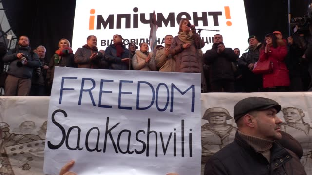 Supporters of exGeorgian President Mikheil Saakashvili hold a rally to protest against Saakashvili's arrest and for the impeachment of Ukrainian...