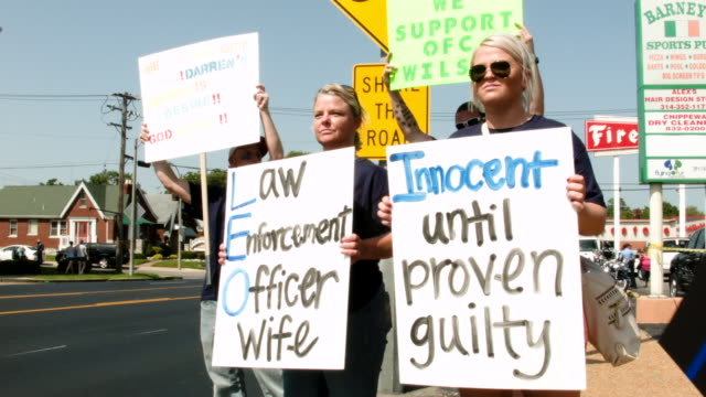 Supporters of Ferguson Missouri police officer Darren Wilson make a statement during a rally Wilson shot and killed 18yearold Michael Brown during an...