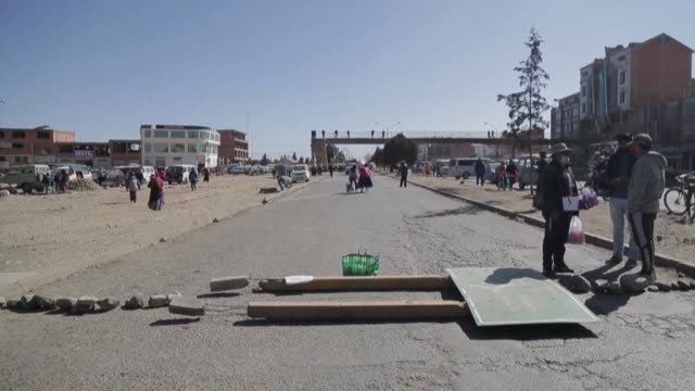 supporters of former bolivian president evo morales set up roadblocks limiting access between la paz and el alto as others stage a protest outside... - former stock videos & royalty-free footage