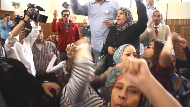 supporters of former egyptian president hosni mubarak chant slogans and hold signs at the cairo high court during a hearing for charges of killing... - president of egypt stock videos & royalty-free footage
