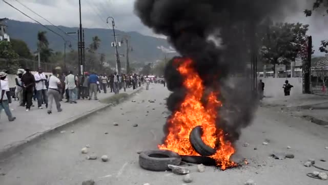 Supporters of former Haitian president JeanClaude Duvalier set fire to tyres and blocked roads in protest at corruption charges that were filed...