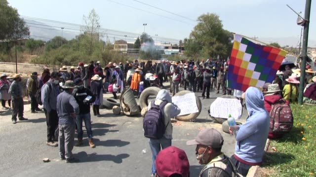 supporters of former leftist president evo morales block roads in cochabamba bolivia against the postponement of the general elections from september... - former stock videos & royalty-free footage