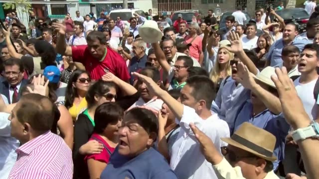 supporters of former peru president alan garcia gather in front of the hospital where he was brought after shooting himself in the head as police... - former stock videos & royalty-free footage