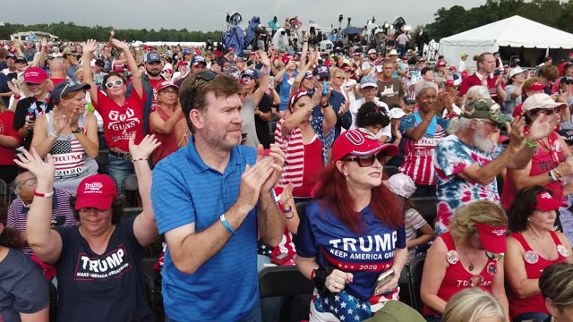"""supporters of former u.s. president donald trump raise their hands in praise as christian music is performed during trump's """"save america"""" rally at... - gulf coast states stock videos & royalty-free footage"""