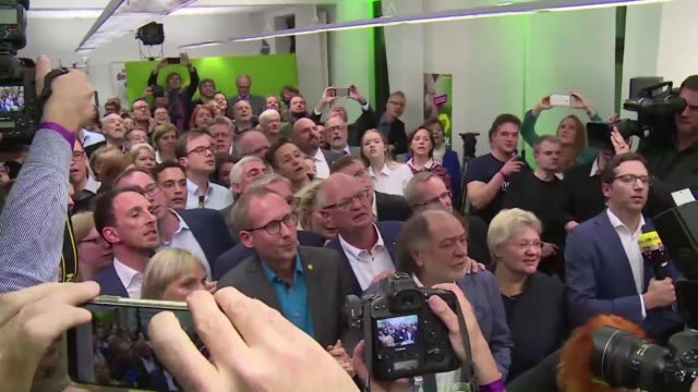 supporters of germany's green party celebrate initial exit polls which show their party has won around twenty percent of ballots in hesse state... - allemagne stock videos & royalty-free footage