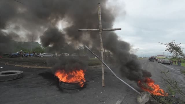 Supporters of Honduran opposition candidate Salvador Nasralla set up a roadblock north of the capital after the electoral authorities concluded a...