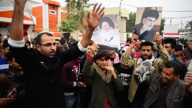 supporters of iraqi shiite cleric moqtada sadr lift portraits of him and his father grand ayatollah mohammad sadiq al sadr at a rally near his... - najaf stock videos & royalty-free footage