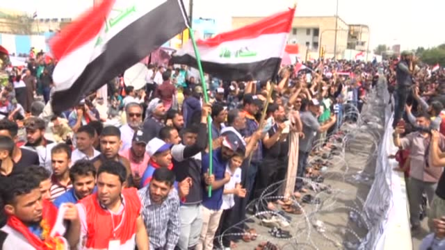 supporters of iraqi shiite cleric muqtada alsadr continue sitin at the entrances to the green zone which houses the prime minister's office and... - muqtada al sadr video stock e b–roll