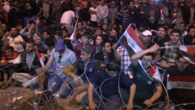 supporters of iraqi shiite cleric muqtada alsadr continue sitin at the entrances to the green zone which houses the prime minister's office and... - muqtada al sadr stock videos & royalty-free footage