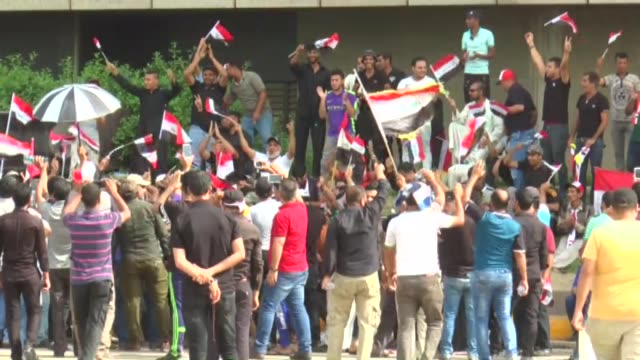 supporters of iraqi shiite cleric muqtada alsadr gather outside of the iraqi parliament building in the socalled 'green zone' in central baghdad iraq... - muqtada al sadr stock videos & royalty-free footage