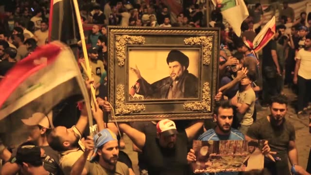 supporters of iraq's sairoon coalition celebrate at baghdad's tahrir square after early results of iraq's general election were announced on may 14... - muqtada al sadr stock videos & royalty-free footage