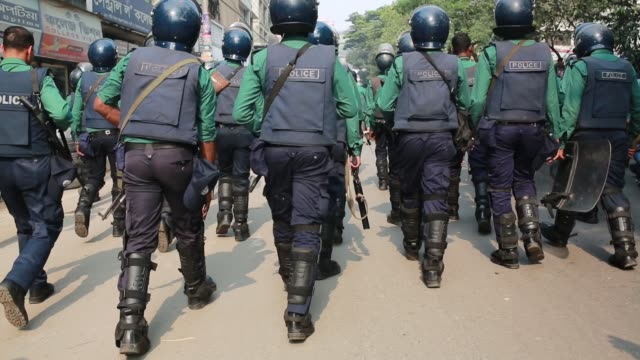 Supporters of Islamist group Hefazot e Islam protest as police block their rally intending to reach the United State's embassy in the Bangladeshi...