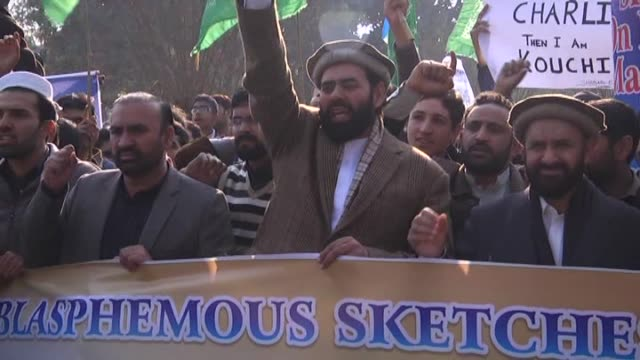 supporters of jamaateislami political party gather to protest against french satirical magazine charlie hebdo for publishing cartoons depicting... - muhammad prophet stock videos & royalty-free footage