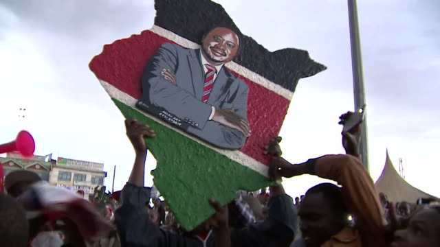 Supporters of Kenyan President Uhuru Kenyatta in the streets of Nairobi as the Supreme Court decide whether to go ahead with a rerun of the...