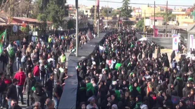 supporters of lebanon's shiite movement hezbollah take part in a procession on the tenth day of muharram which marks the day of ashura in baalbek - ashura muharram stock-videos und b-roll-filmmaterial