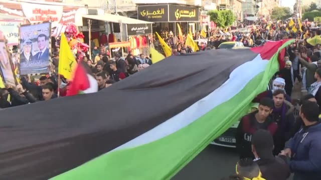 supporters of mohammed dahlan a longtime rival of palestinian president mahmud abbas rally to celebrate the palestinian fatah movement's 55th... - palestine liberation organisation stock videos & royalty-free footage